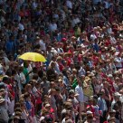 Crowd with a yellow umbrella